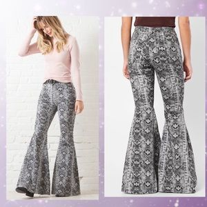 Free people Just Float On Snake Print Flare Jean